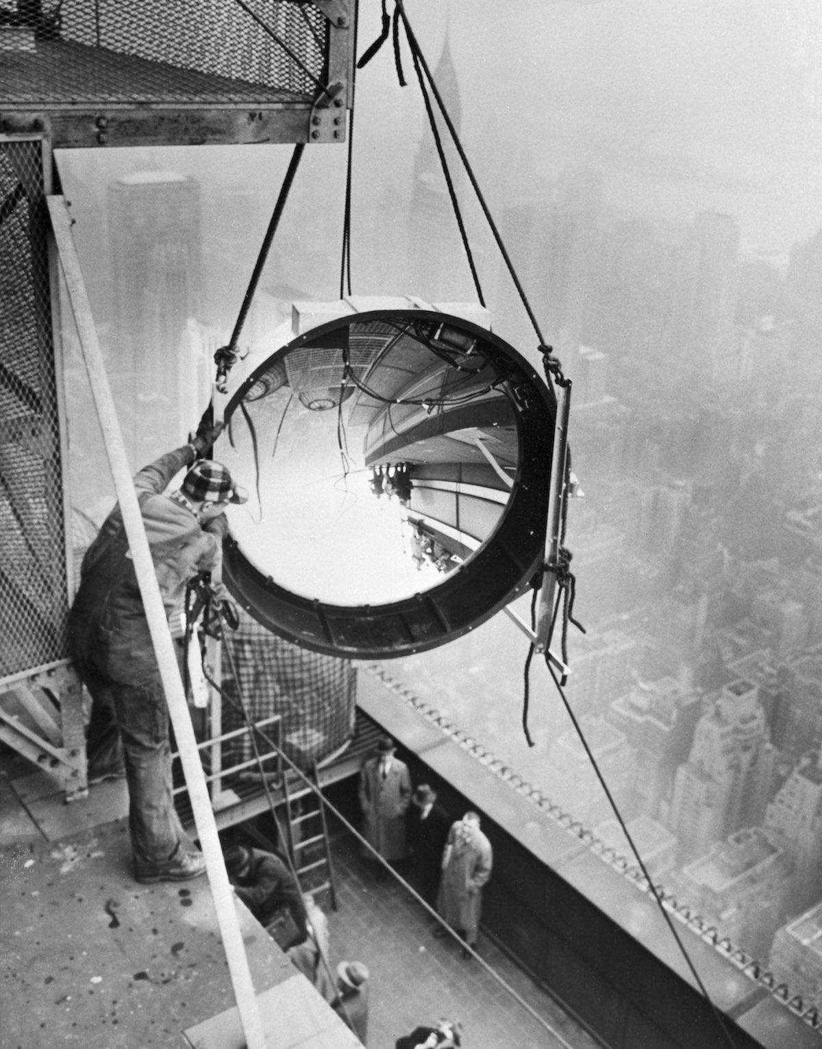 Workmen Install Light On Empire State