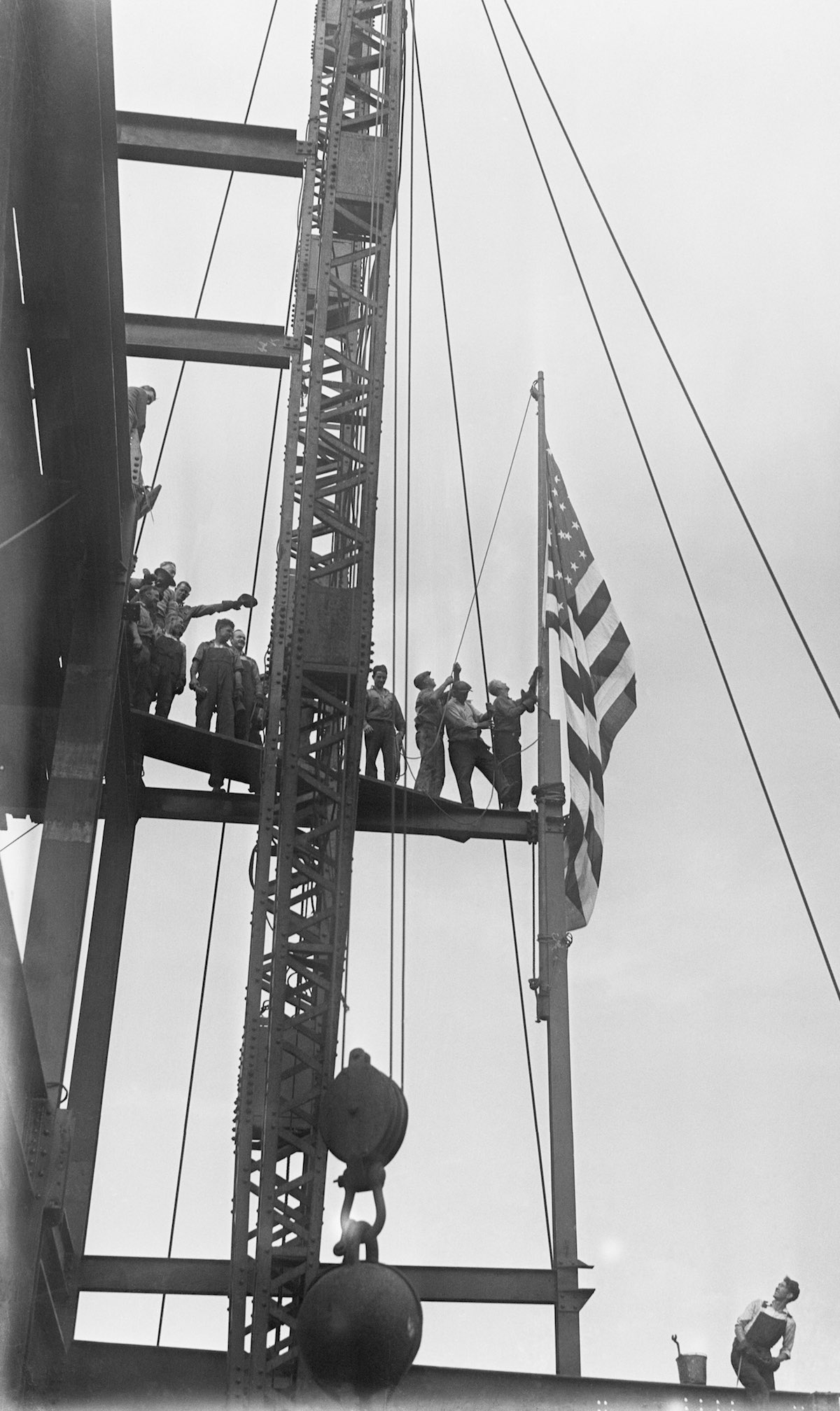Workmen Raise Flag At The Empire State