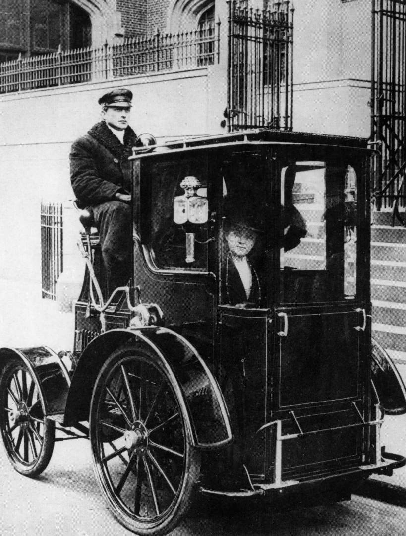 Woman passenger in a 1910 taxi cab, New York, USA, (c1910?).
