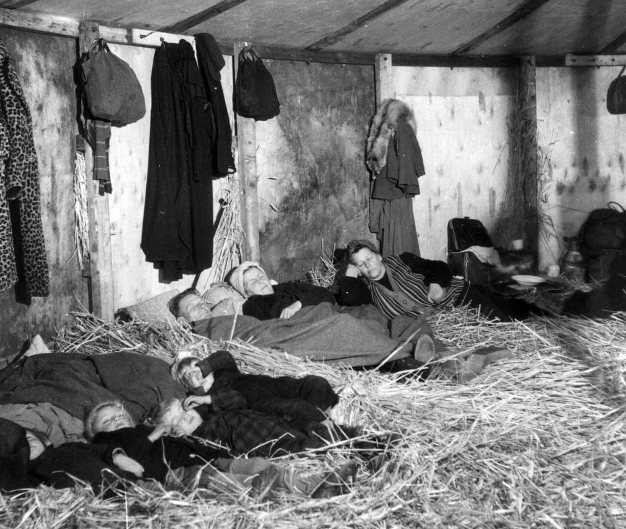 25th October 1945: German refugees fleeing from the Russian zone in the first few weeks after the end of World War II in Europe. They are sleeping on straw in a makeshift transit camp at Uelzen in the British zone of Germany. (Photo by Keystone/Getty Images)