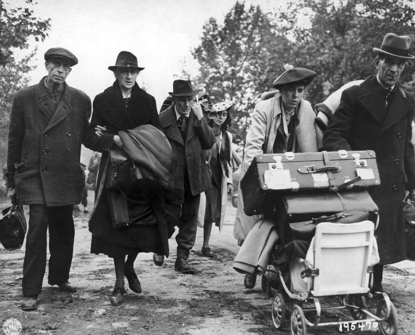 German civilian refugees walking through the streets of Aachen, Germany, on their way to a safer area away from the combat zone, 15th October 1944. (Photo by FPG/Hulton Archive/Getty Images)