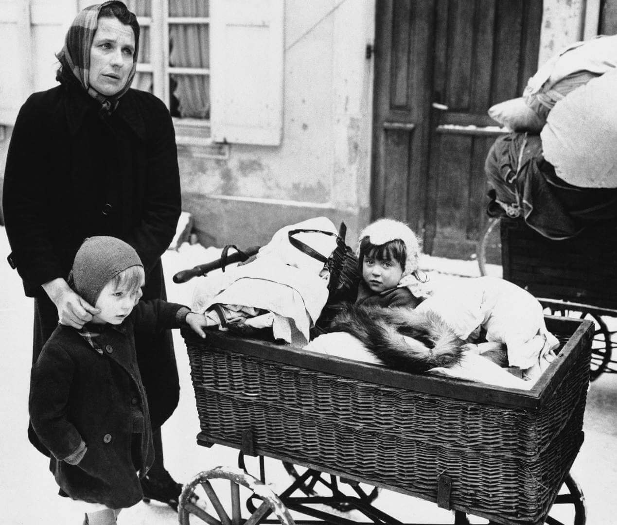 Frenchwoman with two children and belongings loaded on a baby carriage seen in Haguenau, France on Feb. 20, 1945, before they started on their long trek to a safe rear area. They are some of the refugees leaving the town because of the planned withdrawal of the 7th U.S. Army. Many civilians prefer to leave their homes and seek safety in a rear area, rather than suffer another German occupation or risk being conscripted into the German Vollksturn. (AP Photo)