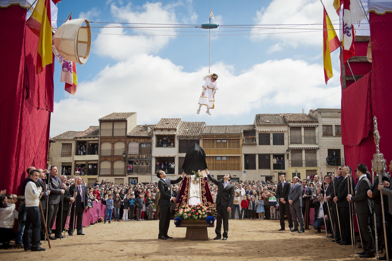 Pablo Leal Requejo plays the role of an angel during the 'Bajada del Angel' Eastern Holy Week celebration in Penafiel, Spain, Sunday, April 8, 2012. During the 'Bajada del Angel' celebration a boy represents an angel appearance unveiling the Virgin's face from a black cloth, a sign of mourning for the death of Jesus, and announces the resurrection of Christ.(AP Photo/Daniel Ochoa de Olza)