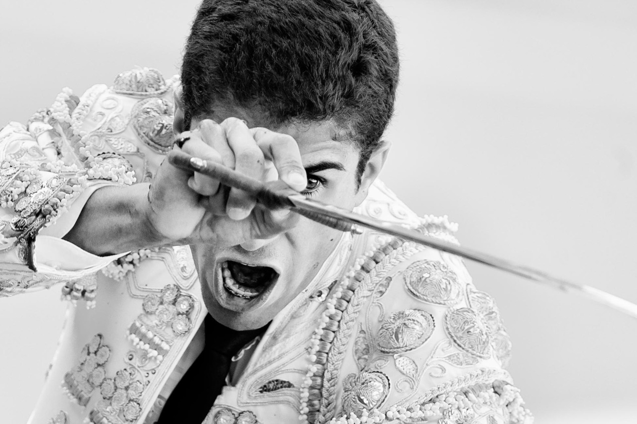 Spanish bullfighter Rafael Cerro aims his sword before killing a bull with it during a bullfight at Las Ventas bullring in Madrid Sunday, June 23, 2013. Bullfighting is an ancient tradition in Spain and the season runs from March to October. (AP Photo/Daniel Ochoa de Olza)