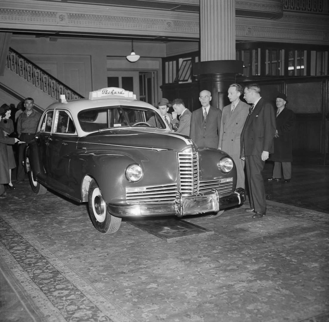 Packard Officials Introducing New Postwar Taxi