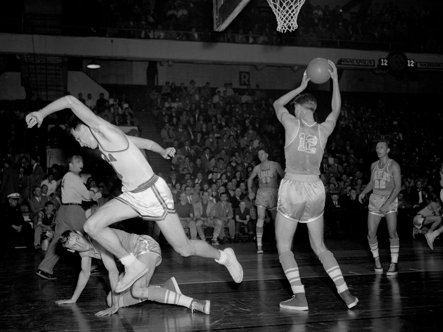 PHILADELPHIA, PA - DECEMBER 21: Howie Schultz #12 of the Minneapolis Lakers rebounds against the Philadelphia Warriors on December 21, 1951 at the Philadelphia Civic Center in Philadelphia, Pennsylvania. NOTE TO USER: User expressly acknowledges and agrees that, by downloading and or using this photograph, User is consenting to the terms and conditions of the Getty Images License Agreement. Mandatory Copyright Notice: Copyright 1951 NBAE (Photo by Charles T. Higgins/NBAE via Getty Images)