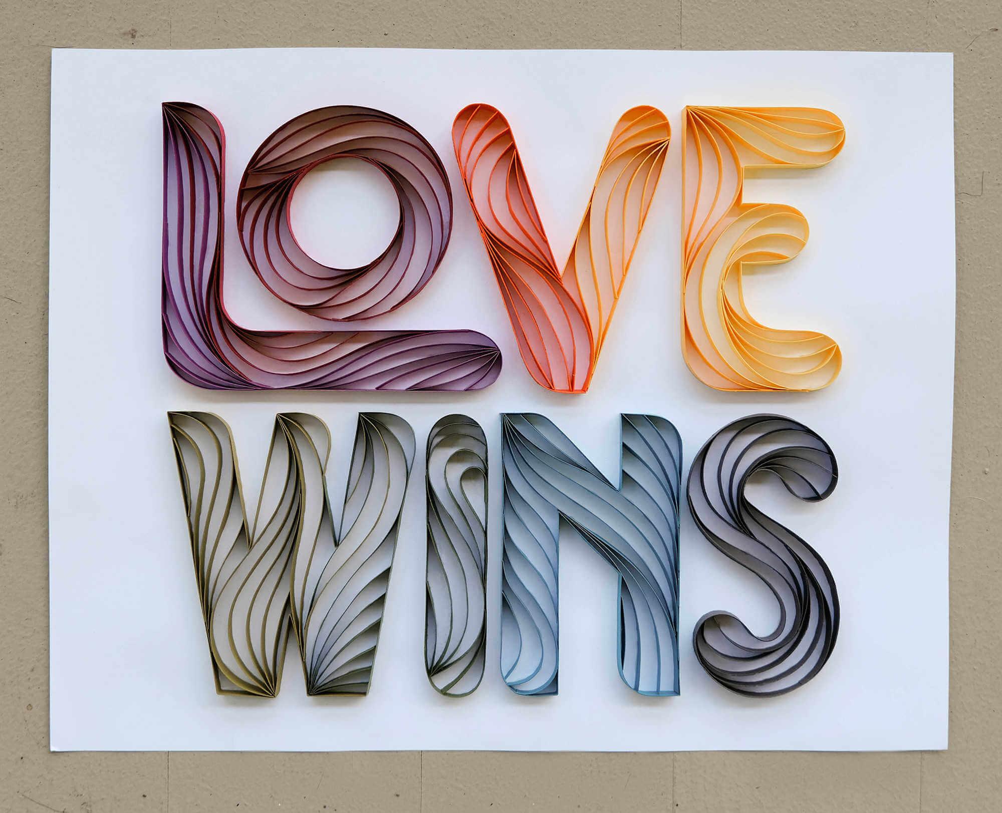 love wins lettering en papel